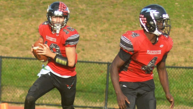 Manchester quarterback Antonio Bisciotti (left) and running back Osman Kanu could not get the Falcons in the end zone against Lakeland.