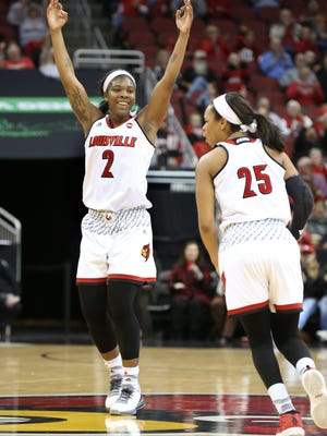 U of L's Myisha Hines-Allen (2) celebrated her teammate Asia Durr's 3-point goal over Maryland during their game at the KFC Yum! Center.  Dec. 1, 2016
