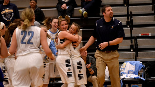 River Valley players and coach Tim Chiles celebrate a Division II girls basketball district championship Friday night at Westerville Central. The Vikings are making their second trip to the Sweet 16 in three years.