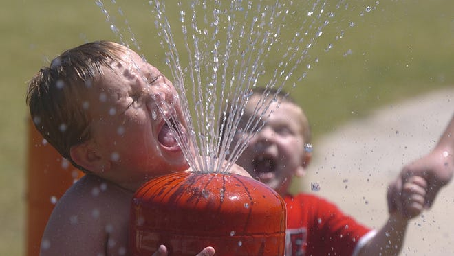 Ashton Anderson, 5, tries to get a drink in the water feature at Wes Bennett Park in south Salem Thursday July 2, 2009.