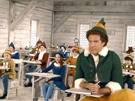 "Will Ferrell (right) in a scene from the holiday film, ""Elf."""