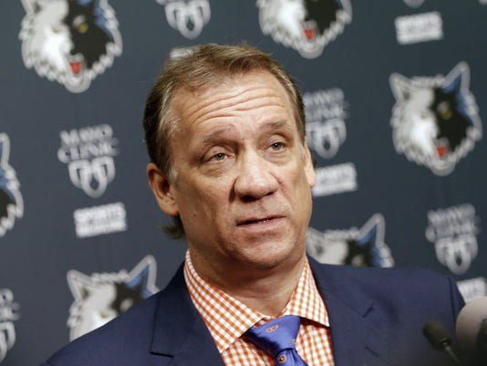 FILE - In this June 25, 2015, file photo, Minnesota Timberwolves president and coach Flip Saunders addresses members of the media during an NBA basketball news conference in Minneapolis. Sam Mitchell will replace Saunders as coach of the Timberwolves in the interim while Saunders continues treatment for cancer, a person with knowledge of the situation told The Associated Press on Thursday, Sept. 10, 2015. (AP Photo/Jim Mone, File)