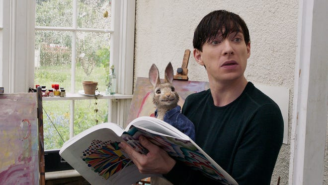 "Thomas McGregor (Domhnall Gleeson) gets close with Peter in ""Peter Rabbit."""