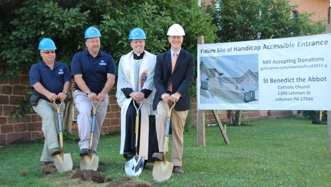 From left: Bill Koch, field superintendant for Wickersham Construction; Joseph Dougherty, vice president of Wickersham Construction; Rev. Michael Rothan; and architect Joseph Connor of Beers and Hoffman break ground on a project to build an elevator in St. Benedict the Abbot Church at 1301 Lehman St. in Lebanon.