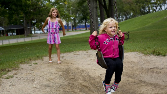 JEFFREY M. SMITH/TIMES HERALD Azlea Schnepp, 3, of Port Huron, is pushed by her sister, Lily Ramsey, 9, on a swing set Friday at Marysville City Park. The city has a park goal-setting session on Sept. 21. Azlea Schnepp, 3, of Port Huron, is pushed by her sister, Lily Ramsey, 9, on a swing set Friday, September 11, 2015 at Marysville City Park.