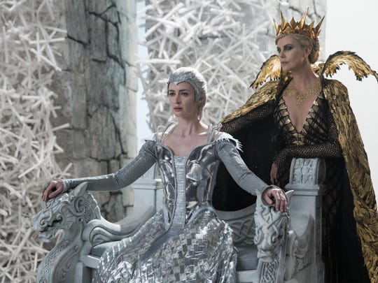 "Emily Blunt, left, and Charlize Theron appear in a scene from ""The Huntsman: Winter's War."""