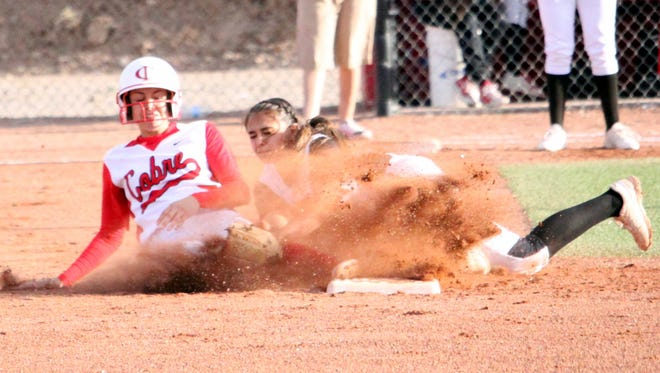 Cobre's Danni Misquez slides into second base attempting a steal. She was called out on the play Wednesday evening in Bayard against Morenci.