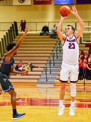 Milford's Kyle Soderberg (23) takes aim from three-point