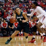 Michigan State's Jasmine Hines, left, drives the baseline against Ohio State's Lisa Blair during the first half of Thursday's contest. Hines had 18 points in Thursday's 85-80 loss.