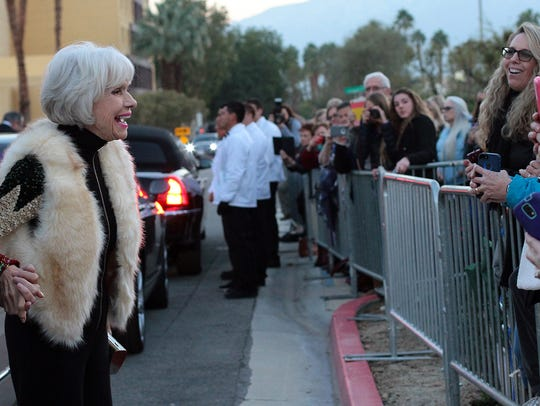 Carol Channing talks with fans after arriving at the