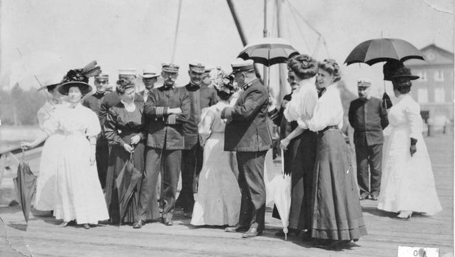 Summer temperature extremes didn't affect fashion in the late 1800s at Puget Sound Navy Yard. Naval officers and their wives gather for an afternoon social event, quite possibly the christening of a new ship. To see more photos from the Kitsap County Historical Society Museum archives, visit facebook.com/kitsaphistory, kitsapmuseum.org, or stop by the museum at 280 Fourth Street in Bremerton. Call 360-479-6226 for information.