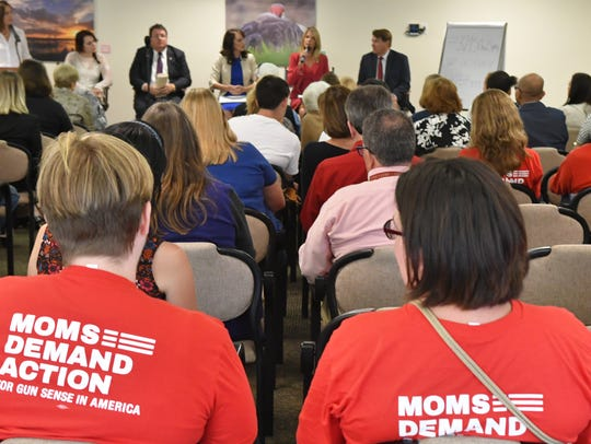 People wearing Moms Demand Action t-shirts attended FLORIDA TODAY's town hall on school safety on March 28.