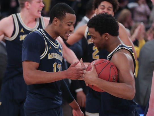 Michigan won the Big Ten tournament for the second straight season with a 75-66 victory over Purdue at Madison Square Garden.