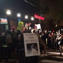 Protesters stopped outside the 12 News studio on Van Buren Street Saturday night during a march through Downtown Phoenix.