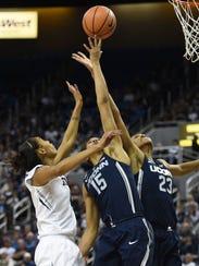 Nevada's Terae Briggs battles battles for a rebound