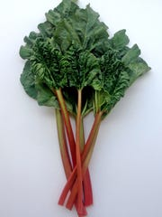 Rhubarb leaves, while pretty, are poisonous; remove before cutting up the stalks.