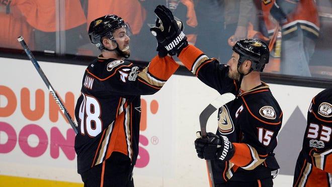 Ryan Getzlaf (15) and Logan Shaw (48) celebrate the Ducks' Game 1 win.