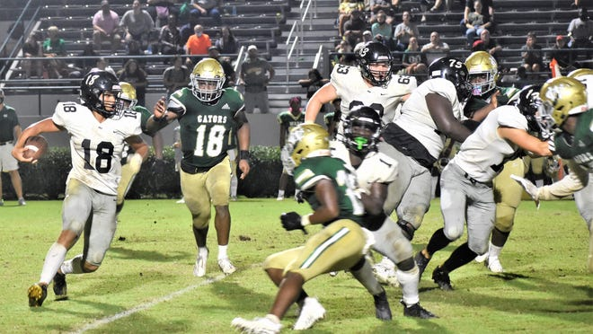 Richmond Hill's Isaiah Allen looks for an opening in a game at Ware County Friday night.