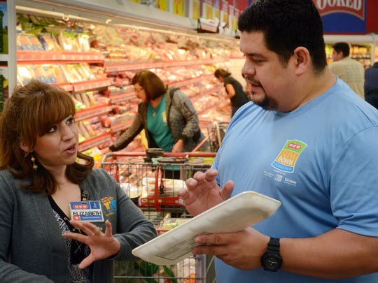 H-E-B dietitian Elizabeth Rios (left) talks with Corpus Christi Slim Down Showdown contestant Rocky Bloom about his selection in the meat market area during a pantry makeover at the H-E-B Plus! on Saratoga Boulevard in late January.