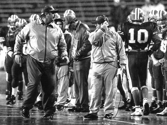 Albany football coach Denney Faith coaches from the sidelines during a game in 1991.