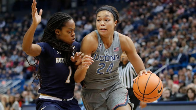 Connecticut Huskies forward Napheesa Collier drives the ball against Notre Dame Fighting Irish guard Lili Thompson in the first half at XL Center.