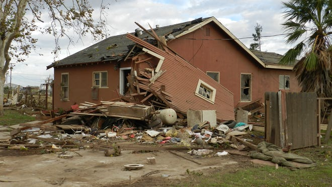 Debris lies on the ground where Sabina and Zane Woodard's garage once stood after reports of a rare tornado in Denair, Calif., Sunday, Nov. 15, 2015. The National Weather Service said video and witness reports confirm a tornado touched down in Denair, which tore roofing and walls, knocked down trees and power lines and damaged gas lines.