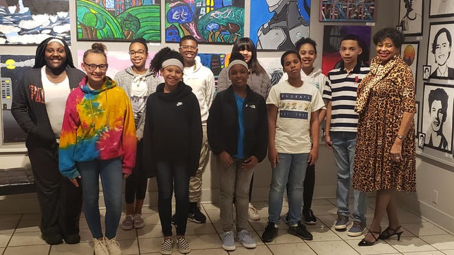 """Teacher Mary """"The Fox"""" Johnson brought several sixth grade students from Ardmore Middle School to The Goddard Center Tuesday evening for live screening of """"Porgy and Bess"""" from the Metropolitan Opera."""