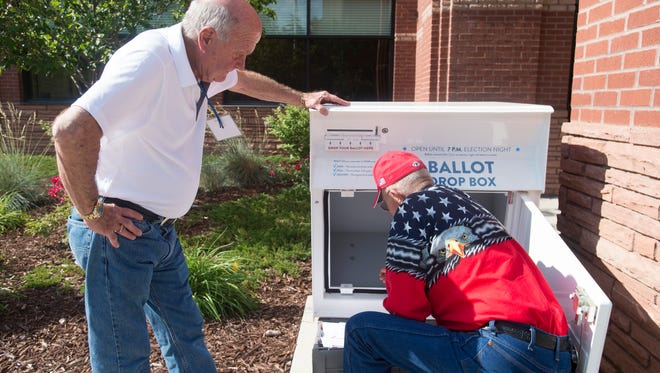 Lary Steinhauer and Dave Jehu unload a ballot box outside the Larimer County Courthouse on Election Day, Tuesday, June 26, 2018.