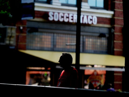 A person walks past Soccer Taco in Knoxville, Tennessee