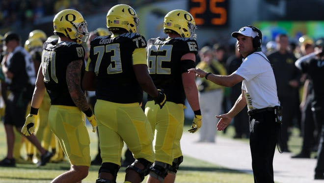 Sep 5, 2015; Eugene, OR, USA; Oregon Ducks head coach Mark Helfrich talks on the side line with Oregon Ducks offensive lineman Matt Pierson (62) Oregon Ducks offensive lineman Tyrell Crosby (73) and Oregon Ducks tight end Evan Baylis (81) against the Eastern Washington Eagles at Autzen Stadium. Mandatory Credit: Scott Olmos-USA TODAY Sports