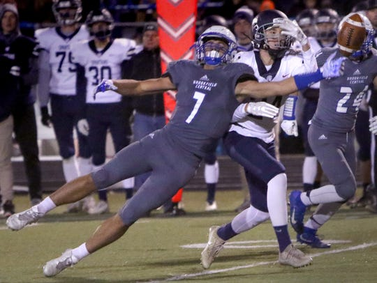 Brookfield Central's Julian Banda stretches for an