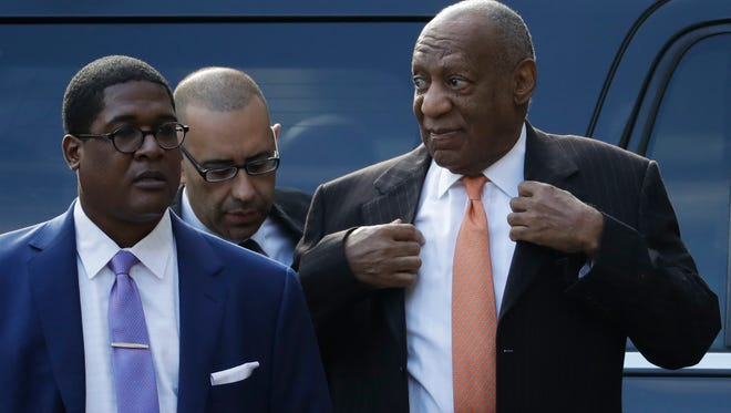 Bill Cosby arrives with publicist Andrew Wyatt, left, on Tuesday, the second day of his sexual assault retrial.