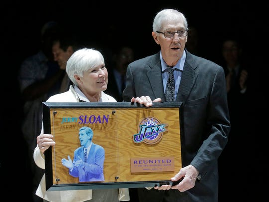 Utah Jazz owner Gail Miller and former coach Jerry Sloan pose for a photograph during a 20-year reunion ceremony for the basketball team that reached the 1997 NBA Finals, at halftime of the Jazz's game against the New York Knicks on Wednesday, March 22, 2017, in Salt Lake City.