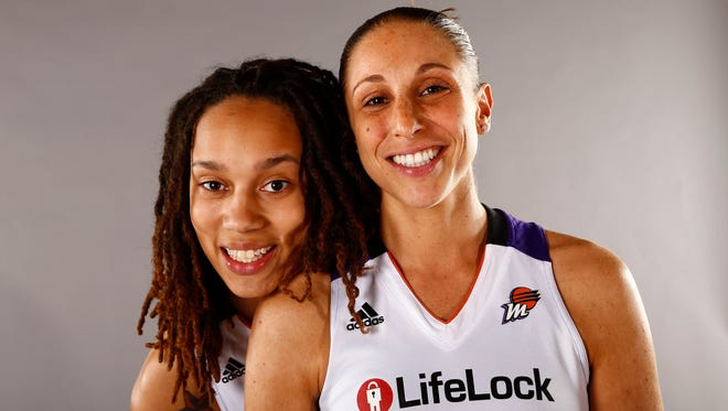 Brittney Griner and Diana Taurasi pose for a photo during the 2013 Phoenix Mercury media day.