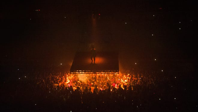 Kanye West performs his Saint Pablo tour on a floating stage Wednesday at Joe Louis Arena.