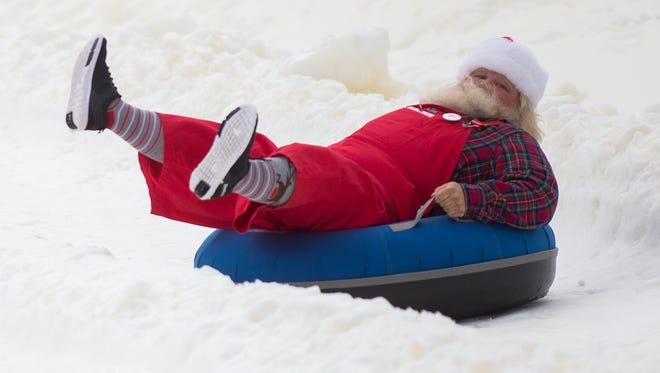Santas race down the snow tubing park at Ober Gatlinburg on March 17, 2017. Santas from several states came to Ober Gatlinburg to compete in a snow tubing race.