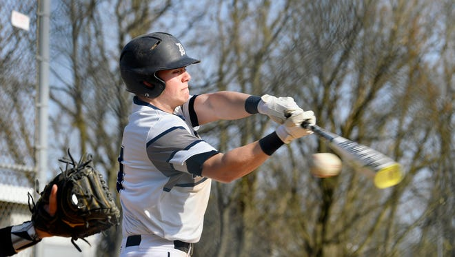 Dallastown's Alex Weakland swings for a strike against Northeastern during a YAIAA baseball game Wednesday, April 18, 2018, at Dallastown. Dallastown shut out Northeastern 5-0.