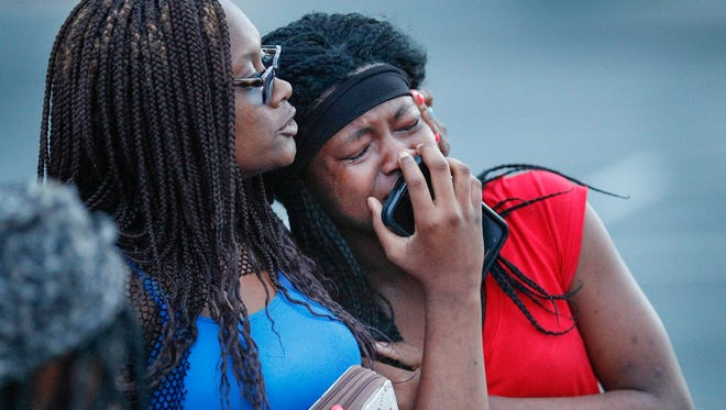 Shanita Yates, left, comforts Sharaya Yates at the vigil for Trevon Bonds on Wednesday, June 27, 2018. The recent Lawrence North graduate who played on the football team was found fatally shot in a west-side apartment.