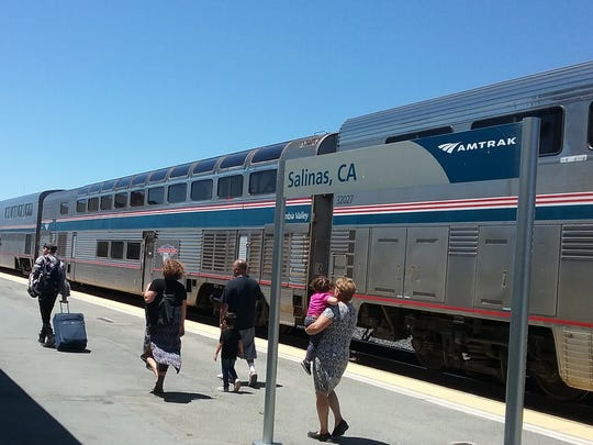 Wednesday rail passengers board the only passenger train that stops in Salinas, slated for elimination under the proposed federal budget.