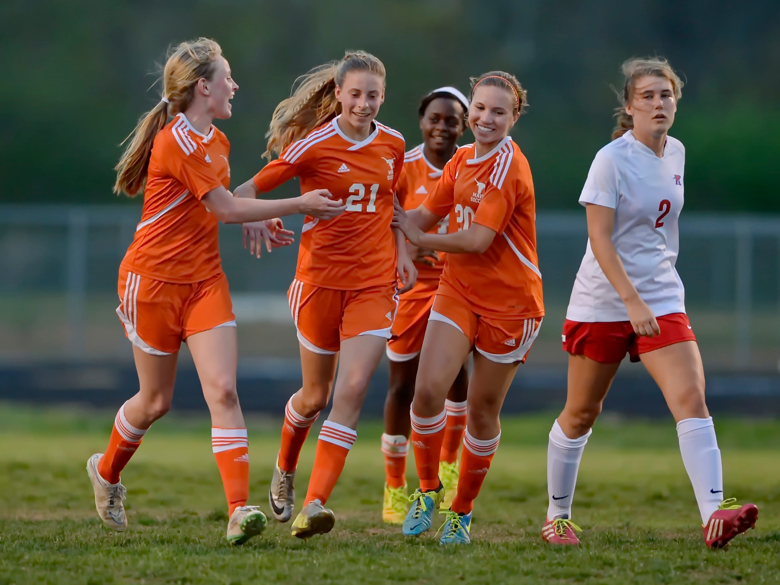 Mauldin's Renee Guion (21) celebrates her first half goal with teammates Reece Diaz-Verry, right, Samantha Britt, left, and Meghan Edwards during the Mavericks' 3-0 win at Riverside Thursday.