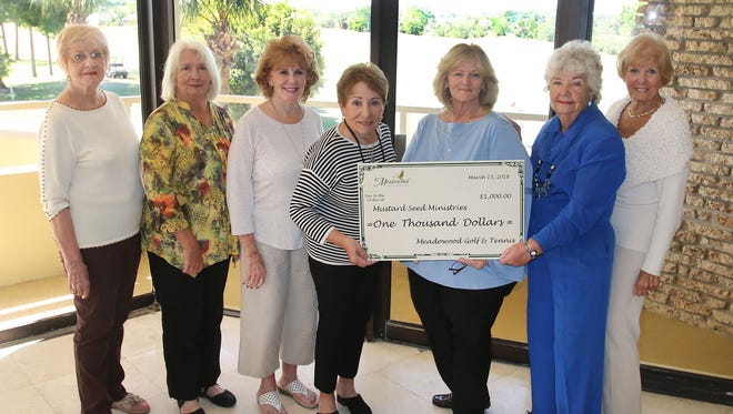 Members of Meadowood's Social Committee present a check for $1,000 to Mustard Seed Ministries' Program Director Stacy Malinowski. Pictured are, from left, Donna Murray, Marlene Thurman, Mary Wolosin, Bette Notte, Malinowski, Silence Andrews, and Mary Jane Doria/