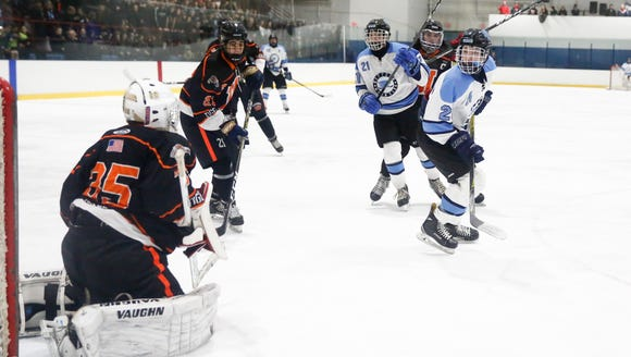 Suffern's Ryan Schelling (26) watches the puck go past