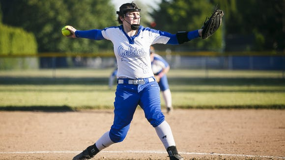 McNary's Faith Danner pitches Grant High School in the first round of the OSAA 6A state playoffs on Monday, May 22, 2017, at McNary High School in Keizer, Ore. McNary defeated Grant 18-14.