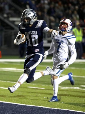 Fairless' Hunter Campbell celebrates as he crosses the goal line on a touchdown run against Tuslaw during the 2019 season finale.