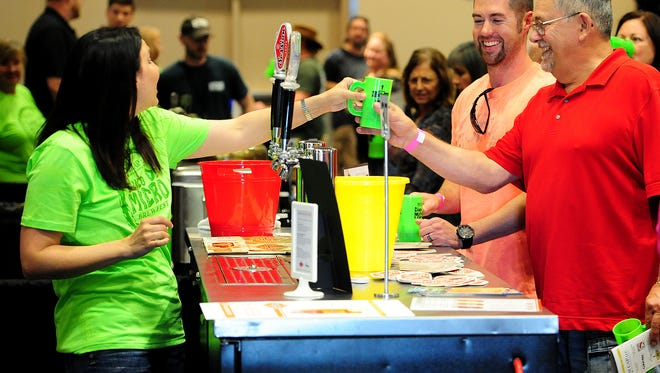 Participants enjoy beer at Cinco de Micro at the Salem Convention Center last year.
