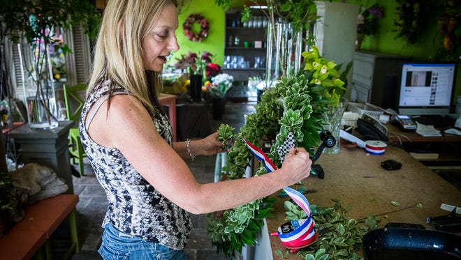 Julie Harman Vance builds the Indy 500 Wreath for the 100th race at her shop, Buck Creek in Bloom, Thursday morning.  Vance has crafted the wreath for the last 24 years.