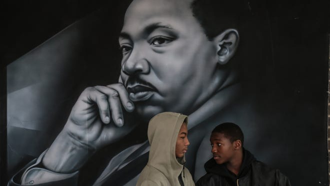 Airbrushed murals of Dr. Martin Luther King Jr. hang in a hallway as students wait to take part in the 8th Annual Martin Luther King Jr. Legacy March on Monday January 16, 2017 at Martin Luther King, Jr. Senior High School in Detroit.