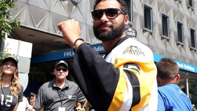 Penguins defenseman Trevor Daley reacts to the fans during the Stanley Cup championship parade and rally in downtown Pittsburgh on June 14.