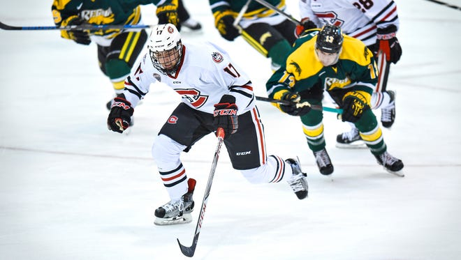 St. Cloud State's Jacob Benson breaks away with the puck during the Saturday, Sept. 30, exhibition game against the University of Regina at the Herb Brooks National Hockey Center in St. Cloud.