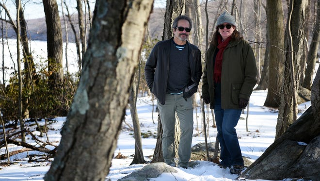 """Elliott Ruga and Julia Somers of the Highland Commission in the Highlands on Wednesday. """"The value of these forests is that they're so deep, they act to insulate a lot of rare species of plants and animals from roads and people,"""" Ruga said."""